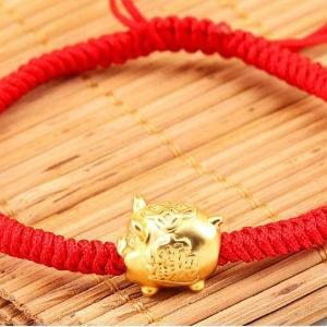 Vòng chỉ đỏ heo vàng đẹp